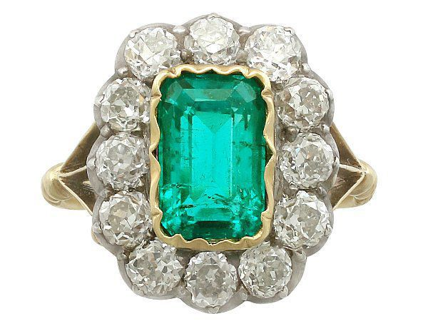 Emerald cluster engagement ring