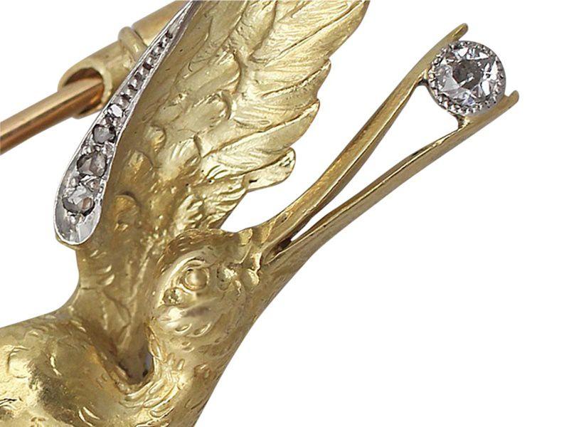 antique stork brooch
