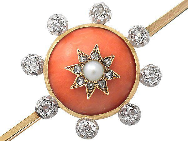 coral diamond brooch